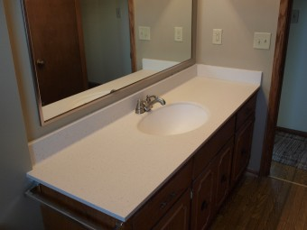 Romanite Vanity Tops Are A One Piece Construction The Top Inegral Bowl With Overflow And Back Splash Formed To Create Smooth Continous Surface